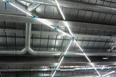 Lighting System (Jocey K) Tags: madrid lighting building reflections spain stainlesssteel ceiling caixaforum archtiecture industrialarchitecture caixaforummuseummadrid