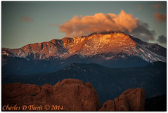 First light on Pike's Peak (ctofcsco) Tags: usa clouds sunrise canon landscape photo colorado unitedstates image gardenofthegods explore telephoto coloradosprings co 5d rockymountains 1500 28300mm pikespeak 56 morningsun firstlight gleneyrie 2014 kissingcamels 180mm superzoom eos5d explored ef28300mmf3556lisusm mesaroad 14110 ef28300mm 5dclassic mesaroadoverlook 5dmark1 5dmarki