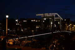 "Amsterdam at night, with its famous ""Magere Brug"". (monika & manfred) Tags: holland netherlands amsterdam architecture nederland thenetherlands cityscapes canals nightshots mm atnight grachten niederlande waterways lightindarkness lowlightshots"