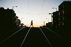 Evening crossing (Robert Ogilvie) Tags: muni wired foundinsf contax167mt gwsf kodakektar100