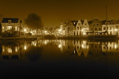 Korte Spaarne (McQuaide Photography) Tags: longexposure nightphotography holland reflection haarlem water netherlands spaarne sepia night canon river boot eos lights mono licht boat europe glow cityscape nacht tripod nederland wideangle le dslr toned lightroom uwa rivier wideanglelens lichten ultrawideangle 100d 1018mm mcquaidephotography kortespaarne