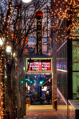 Sidewallk on Main St., Kansas City (ericbowers) Tags: city light sunset urban usa trafficlights green window vertical wall night evening town us twilight holidays downtown cityscape exterior unitedstates zoom dusk citylife nopeople streetscene illuminated christmaslights mo kansascity sidewalk missouri streetphoto stoplight amc turnsignal businessdistrict downthestreet buildingexterior amctheatres movingdown mainstreettheater builtstructure alamodrafthousetheater downthesidewalk
