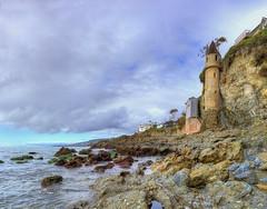 Late Afternoon at Victoria Beach (Non Paratus) Tags: orangecounty lagunabeach victoriabeach shore coast water surf pacificocean rocks cliffs tower seascape sky clouds cloudy