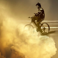 into the unknown future. (Photomaginarium) Tags: pointandshoot powershot geekbehindthecurtain dream dreams sepia bicycle surreal surpriseyourself goodmadness gimp gold streetphotography clouds dramatic art candid street cyclist downtown monotone sunset