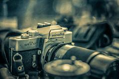 My old Minolta SRT 102 (David DeCamp) Tags: camera photographicequipment oldfashioned retro old tech antique lens black chrome film nostalgia closeup backgrounds classic minolta vintage texture splittone