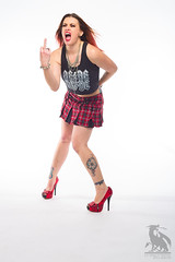 What She Said (CJ Schmit) Tags: wwwcjschmitcom 5dmarkiii canon canon5dmarkiii cjschmit cjschmitphotography canonef50mmf18ii photographermilwaukee milwaukeephotographer photographerwisconsin racine racinewisconsin dragonspitstudios tiffanywoller skirt heelstshirt rocker rockerchick acdc tattoos ink rings bracelets shortskirt pladskirt halfshirt piercings redhair sexy legs redheels hot woman modelshoot studioshoot portrait portraitshoot studiolighting digibeedb800 buff51 white plmpocket wizardshigh contrast red calednoia wisconsin