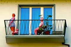 Look Close: They're Always Home... (Dan Daniels) Tags: whimsy windows balcony basel kantonbaselswitzerland baselstadt funny switzerland mannequins sun surrealism