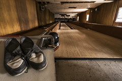 One last string. (Element1983) Tags: bowling bowlingalley wood ball shoes wide zeiss 18mm longexposure sony a7ii alpha abandoned forgotten decay old cigarette dusty