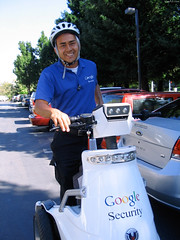 "Google Security guy on electric scooter • <a style=""font-size:0.8em;"" href=""http://www.flickr.com/photos/34843984@N07/14926013463/"" target=""_blank"">View on Flickr</a>"