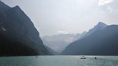 Banff NP ~ Lake Louise (karma (Karen)) Tags: canada mountains clouds boats vanishingpoint haze glare smoke lakes alberta glaciers lakelouise canadianrockies victoriaglacier banffnp canadanationalparks