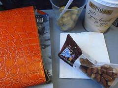 easyjet lunch (the incredible how (intermitten.t)) Tags: food flying tea nuts olives easyjet 25022 orangepurse 20141002 matchingthecoporatecolours