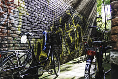 (giovanibr) Tags: street light urban sun netherlands amsterdam bike bicycle wall canon graffiti alley europa europe streetphotography bikes bicicleta holanda rays