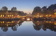 Amsterdam Bridges (Shahid A Khan) Tags: street city travel bridge light urban holland reflection nature water netherlands dutch amsterdam architecture night vintage river photography boat canal europe cityscape arch view image photos dusk famous capital bridges landmark scene images panoramic vehicles drawbridge amstel descriptivewords canon5dmark2 shahidakhan sakhanphotography wwwgalleryskcom