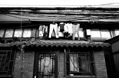 Mess of lines (Grace (Bingyan S)) Tags: windows blackandwhite lines beijing streetphotography clothes hutong