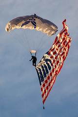USAF Parachutist with Stars n Stripes (Rami Khanna-Prade) Tags: sunset stars warrington florida stripes airforce usaf pensacola usflag parachute demoteam starsnstripes npa naspensacola navalairstationpensacola knpa