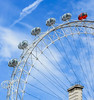 IMG_4618 (Manveer Jarosz) Tags: london londoneye milleniumwheel capsule ferriswheel red wheel blue sky clouds quarter uk architecture attraction capsules circle marvel modern sights tourism travel