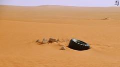 An Abandoned Tyre, Red Sand Desert, Saudi Arabia (RJ-Clicks) Tags: tyre redsand redsanddesert desert sand abandoned road roadtrip rehanjamil rjclicks nikond5100 nikon d5100 pakistaniphotographer photographerindammam photographerinkhobar pakistani