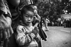 Young faith (Feca Luca) Tags: street reportage portrait people children ritratto blackwhite buddhism buddha buddismo buddhist bimbi religion religione india asia kalachakra nikon