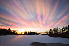 Last Light at Leo Lake (Matt Molloy) Tags: mattmolloy timelapse photography timestack photostack movement motion sunset colourful sky clouds trails sun light lake frozen snow pine trees leolake kingston ontario canada landscape lovelife