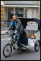 Riding Empty (exreuterman) Tags: london holborn candids street scenes snaps color canon 100d sl1 fitzrovia work cabs taxis pedicabs