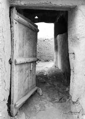 Al Bujairi, Ad Diriyah (Historical), Saudi Arabia (©Yazeed) Tags: lenses lens تصويري عدستي آثار تراث البجيري الدرعية السعودية الرياض yazeed flickr mudwall mud woodendoor door saudiarabia riyadh blackandwhite bw canon2470 canon5d canon5dmarkiv canon