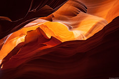Waves of stone (Visualvalhalla) Tags: rock glow slotcanyon watererosion backlight monument patterns sandstone arizona brown yellow wave light exposure erosion red orange background homescreen