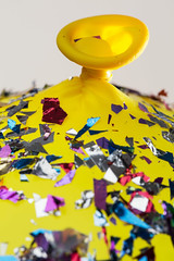 Macro Mondays 10th  Anniversary | Tie-up on Party Hill -[ HMM ]- (Carbon Arc) Tags: macromondays happy10years macro yellow balloon confetti knot tie neck inflate blowup messy colorful festive tenth anniversary birthday decoration celebration fete