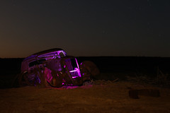 Purple people eater (No Stone Unturned Photography) Tags: abandoned vehicle car arizona desert ryst lightpainting longexposure colored gel lights purple stars night camping