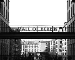I-Tüpfelchen/Me, Myself and (an) I (floressas.desesseintes) Tags: berlin berlinmitte mallofberlin brücke bridge einkaufscenter shoppingmall silhouette silhouettes kontrast contrast kind child streetfotografie schwarzweis crossing übergang