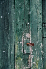 Green Barn Door Behind Falling Snow (AndrewCline) Tags: new hampshire england rural country rustic green door paint wood wooden latch rusted color colorful vintage old weathered texture barn