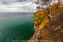 Emerald Fall - Miners Beach Trail (Pictured Rocks National Lakeshore) (Aaron C. Jors) Tags: lakesuperior greatlakes greatlakesshorelines picturerocksnationallakeshore nationallakeshores nationalparks sunsets michigan uppermichigan autumn fall lakesuperiorshoreline yellows greens oranges cloudy overcast cliffs