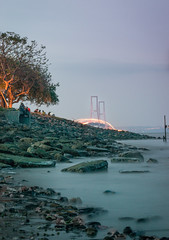 Sunset view at Suramadu bridge (jenvendes) Tags: surabaya indonesia travel beautiful nature sky east landscape java clear landmark sunset longexposure boat water sea clouds night suramadu asia