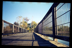 So Much Depends On The Weather (Trippin' all over the place) Tags: park light shadow nature 35mm fence landscape walk grain missouri stcharles sprockets