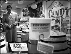 Candy Shopper (greenthumb_38) Tags: blackandwhite man standing walking blackwhite candy duotone blackman balboa shopper balboaisland welldressed jeffreybass sharpdressedwalk