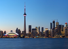 Toronto at Dusk (.annajane) Tags: blue lake toronto ontario canada tower water skyline night bay cityscape cntower waterfront dusk stadium lakeontario rogerscentre