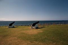 Horizon (Luke Jacob Simon) Tags: ocean blue summer sky green beach vertical analog 35mm canon vintage warm kodak ae1 horizon scenic sun