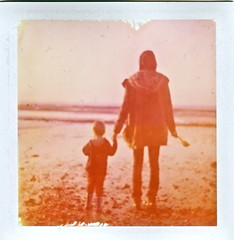 The Lady & The Boy (Tinsoldierman) Tags: color film beach polaroid kid granville viva colorpack pack80