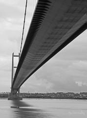 Humber Bridge (Jackie XLY) Tags: blackandwhite bw architecture canon mono britain engineering humber 600d blackandwhitearchitecture canon600d northunited kingdomenglandbritaingreat humberbridgethe bridgehullbridgesbridgeyorkshireeast yorkshirehumbersidegrimsbylincolnshirenorththe