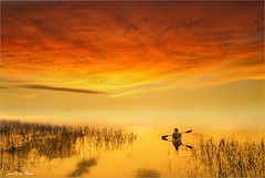 Lost (Jean-Michel Priaux) Tags: sunset orange mist art nature fairytale clouds photoshop river landscape lost see boat alone sailing surreal fairy lonely surrealist unreal paysage fairyland savage lonesome surraliste
