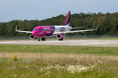 Plane spotting (Alex Babashov) Tags: show new sky france color topf25 plane canon airplane photography photo cool topf50 topf75 europe day photos aircraft jet 100v10f spot basel explore airbus topf100 fr spotting bsl a320 avia wizzair wizz topf500 topf1000 explored airjet anawesomeshot lfsb planespot sotters