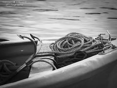 Not anchored (Carmen Cabrera .) Tags: blackandwhite bw blancoynegro cuerda cabo free olympus rope bn anchor libre ancla coiledrope prow e510 proa noanclado notanchored cuerdaenrollada