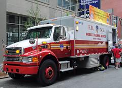 FDNY 150th Aniv. Block Party at the FDNY Museum (zamboni-man) Tags: world new york city rescue bus tower truck fire lights engine best ambulance fireman ladder busses job fdny department siren kme hazmat nyfd seagrave fd firey iaff whelen ferrera