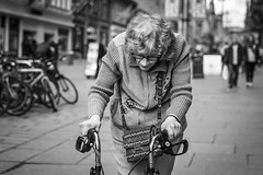 The Struggle Is Real (Leanne Boulton) Tags: streetphotography monochrome people portrait urban street candid portraiture candidstreetphotography candidportrait streetportrait sociallandscape streetlife closeup old elderly age woman female face facial expression emotion feeling mood atmosphere struggle arthritis disability determination mobility tone texture detail depthoffield bokeh naturallight outdoor light shade city scene human life living humanity society culture canon canon5d 5dmarkiii 70mm character ef2470mmf28liiusm black white blackwhite bw mono blackandwhite glasgow scotland uk