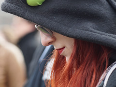 Sideview of a Woman (d_t_vos) Tags: portrait woman girl youngwoman teenager teen candid street streetphotography streetportrait hood hoodie redlips red redhair glasses sunglasses sideview side cheek people crowd perspective lines museumplein amsterdam womensmarch 2017 dickvos dtvos