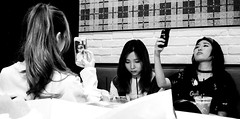 Mirror mirror (www.Michie.ru) Tags: selfie tourists tokyo mirror mirrormirror blackandwhite streetphotography burger cafe beautiful girls teen asiangirl asian nikon candid beauty longhair monocrome cellphone smartphone iphone lunch group youth fashion afternoon break rest conversation culture bored confidence lunchmeeting luncheon girlsout selvies selves faces poses pose posing modeling