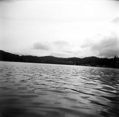 10.2016 LLWM Holga SFX BW Kayaking E0002 (Jcicely) Tags: 2016 bwfilm clouds holga kayaking loonlake loonlakewithmarvin october sky trees water