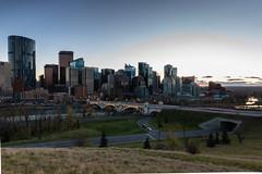 Big City Lights: Calgary Series 'A' (Image 4) (Martin Thielmann) Tags: ab bowriver centrestreetbridge memorialdrive carlighttrails sunsetbehindcalgaryskyline trafficonroads viewfromhillside