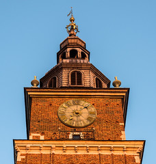 Early Evening Sun Hits The Top of Old Town Hall Tower - Krakow Old Town (Stare Miasto) - Market Square (Rynek Glowny) (Olympus OMD EM1 II & M.Zuiko 12-100mm f4 Pro Zoom)  (1 of 1) (markdbaynham) Tags: krakow cracow poland polish city historic famous stare miasto old town market square platz markt rynek glowny pl oly olympus omd em1 em1ii em1mk2 em1mark2 csc evil mirrorless mft m43 m43rd micro43 micro43rd mzd zd mz mzuiko 12100mm f4 pro travelzoom tower clock polska polen royalroute