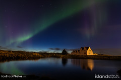 Northern lights over a farm house