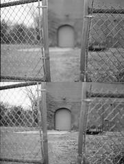 Gateway (Bryce Conor Buchanan) Tags: city streets film canon downtown rooftops springfield canonae1program lomographyfilm
